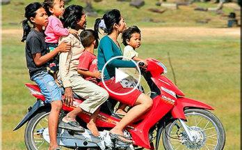 Child driving motorbike