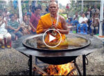 Thai Monk Meditates in Pot of Boiling Oil