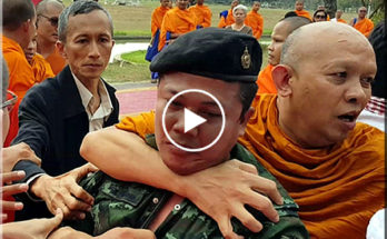 Thai monks fighting with the army